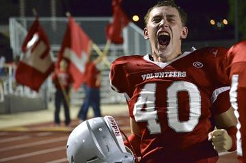 After winning the first football game of the season 17-16 against the Marshall Rams, Defensive End Austin Freund 12 celebrates on the sidelines. For the first time in two years, the football team beat the out-of-district opponent. Photo by Katherine Sotelo