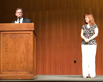Mike Garrison, principal of Austin McCallum High School, accepts the Administrator of the Year Award at the ILPC spring convention at the University of Texas, Sunday, April 19. Looking on is TAJE executive director Rhonda Moore, who nominated him for the award.