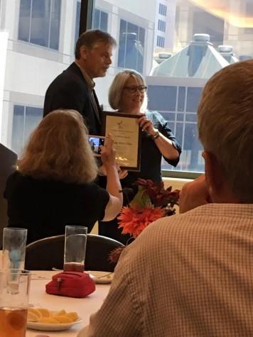 Bobby Hawthorne, Texas Journalism Guru, presents Sandy Hall Chiles with. Trailblazer Award.